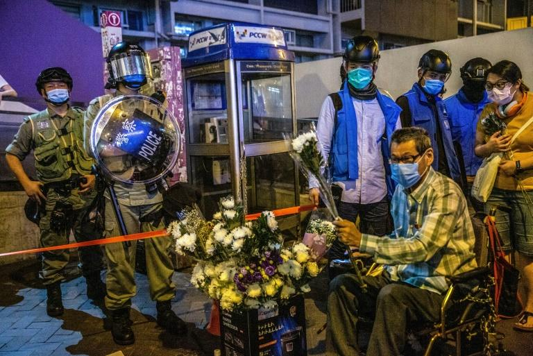 Riot police disperse HK protesters on station beating anniversary