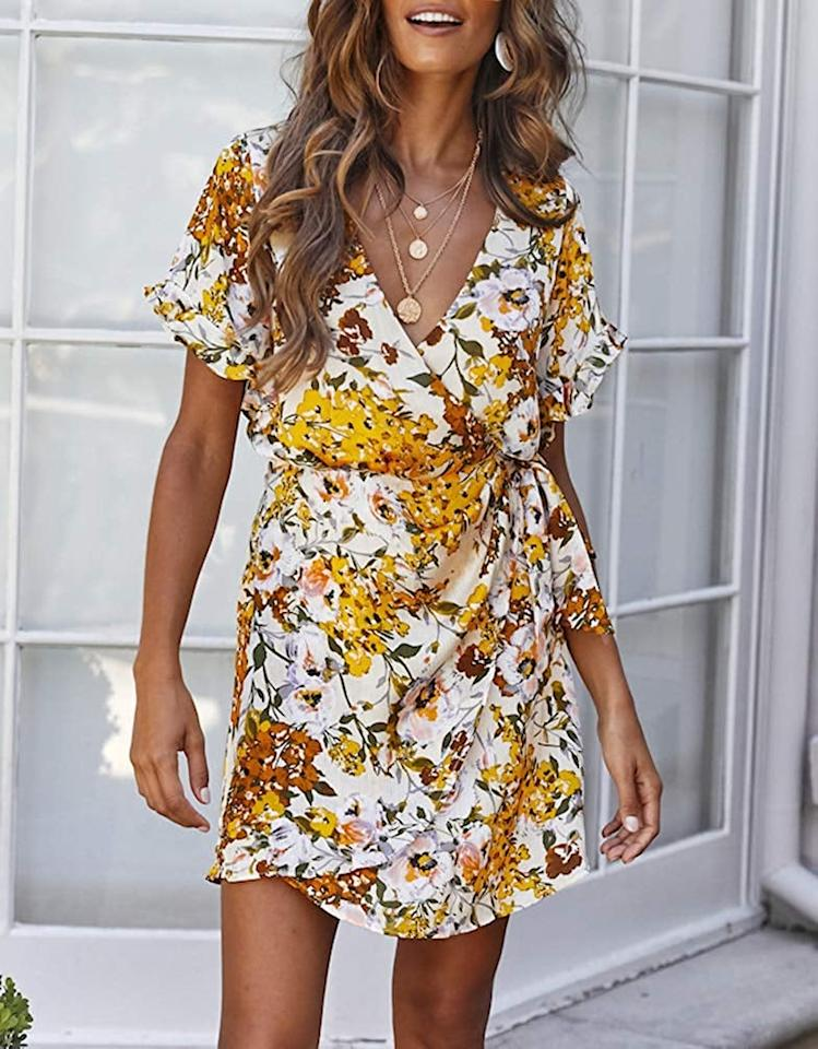"<p>Wear this <a href=""https://www.popsugar.com/buy/Floral-Wrap-Dress-503328?p_name=Floral%20Wrap%20Dress&retailer=amazon.com&pid=503328&price=21&evar1=fab%3Auk&evar9=46310389&evar98=https%3A%2F%2Fwww.popsugar.com%2Ffashion%2Fphoto-gallery%2F46310389%2Fimage%2F46812026%2FFloral-Wrap-Dress&list1=shopping%2Cfall%20fashion%2Camazon%2Csummer%20fashion%2C50%20under%20%2450%2Caffordable%20shopping&prop13=api&pdata=1"" rel=""nofollow"" data-shoppable-link=""1"" target=""_blank"" class=""ga-track"" data-ga-category=""Related"" data-ga-label=""https://www.amazon.com/dp/B07PWCWN8L/ref=va_live_carousel?pf_rd_r=BW4AFGMDQ30PGTJDF3AQ&amp;pf_rd_p=26e161c5-c294-42e3-95c8-c1d9b1acb7cc&amp;pf_rd_m=ATVPDKIKX0DER&amp;pf_rd_t=Landing&amp;pf_rd_i=7141123011&amp;pf_rd_s=merchandised-search-2&amp;pd_rd_i=B07PWCWN8L&amp;th=1&amp;psc=1"" data-ga-action=""In-Line Links"">Floral Wrap Dress</a> ($21) with tan booties and a denim jacket.</p>"