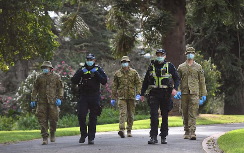 Military personnel have been deployed in the state of Victoria to back up police enforcing lockdown measures - William West/AFP