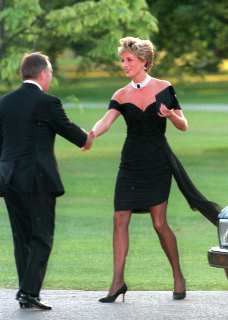 """LONDON - NOVEMBER 20: Diana, Princess of Wales, wearing a stunning black dress commissioned from Christina Stambolian, attends the Vanity Fair party at the Serpentine Gallery on November 20, 1994 in London, England. The famous black """"revenge dress"""" was a spectacular coup by the Princess, worn on the very evening that Prince Charles made his notorious adultery admission on television. (Photo by Anwar Hussein/WireImage)"""