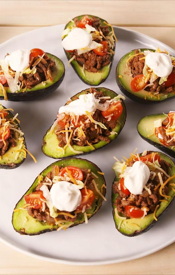 """<p>Pure goodness in the palm of your hand.</p><p>Get the recipe from <a href=""""https://www.delish.com/cooking/recipe-ideas/a19701670/taco-stuffed-avocados-recipe/"""" target=""""_blank"""">Delish</a>. </p>"""