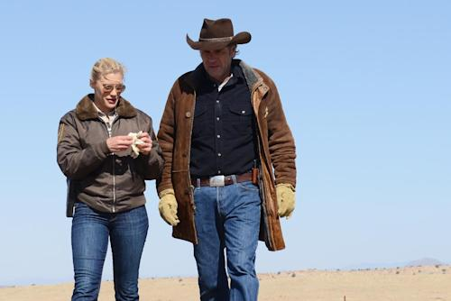 "This undated publicity image released by A&E shows Katee Sackhoff , left, and Robert Taylor in the series ""Longmire,"" returning for a second season on Monday, May 27 at 10 p.m. on A&E. (AP Photo/A&E, Ursula Coyote)"