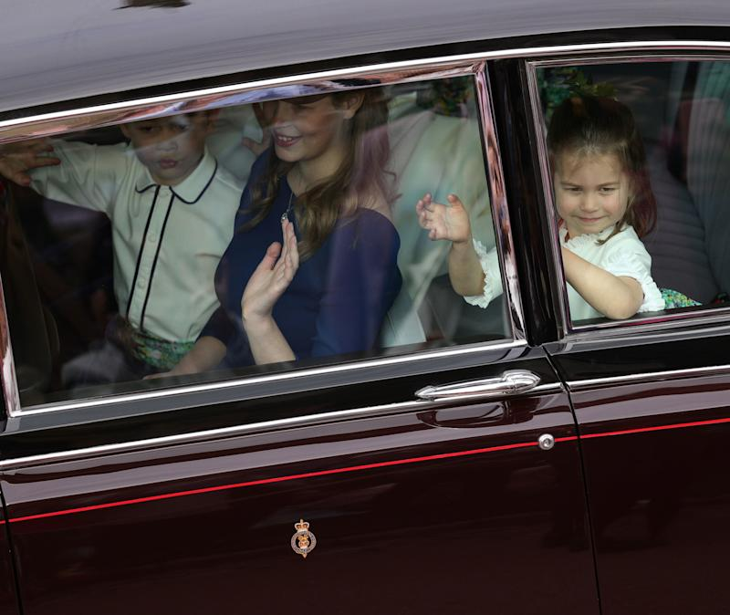 WINDSOR, ENGLAND - OCTOBER 12: Page boy Prince George of Cambridge and bridesmaids Lady Louise Windsor and Princess Charlotte of Cambridge arrive ahead of the wedding of Princess Eugenie of York and Mr. Jack Brooksbank at St. George's Chapel on October 12, 2018 in Windsor, England. (Photo by Aaron Chown - WPA Pool/Getty Images)