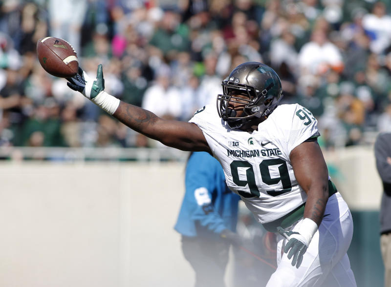 Michigan State defensive lineman Raequan Williams nearly intercepts a pass during a spring NCAA college football scrimmage, Saturday, April 1, 2017, in East Lansing, Mich. (AP Photo/Al Goldis)