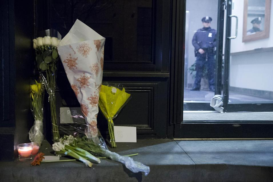 """Flowers are seen out side the home of Philip Seymour Hoffman, Sunday, Feb. 2, 2014, in New York. Hoffman, who won an Oscar for best actor in 2006 for his portrayal of writer Truman Capote in """"Capote"""", was found dead Sunday in his apartment. He was 46. (AP Photo/Matt Rourke)"""