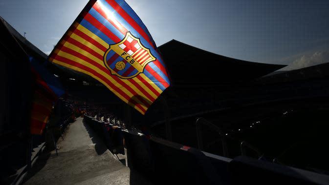 Logo dan ilustrasi Barcelona. (AFP/Pau Barrena)