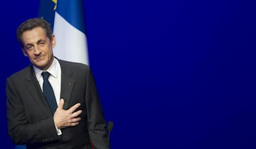 Outgoing French President Nicolas Sarkozy leaves after addressing supporters at his Union for a Popular Movement (UMP) party headquarters after the the preliminary results of the second round of the presidential elections were announced in Paris Sunday May 6, 2012. Almost every crisis-hit European country that has held an election since disaster struck in 2009 has thrown out its leader. (AP Photo/Jacques Brinon)