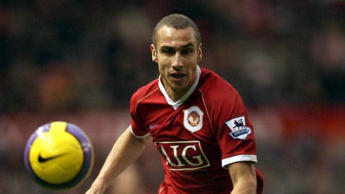 7. Henrik Larsson. striker ini didatangkan MU dari Helsingborgs IF saat usianya 36 tahun pada musim 2006/2007. Dengan status pinjaman, bomber Swedia ini membukukan 13 penampilan dengan torehan tiga gol. (AFP/Paul Ellis)