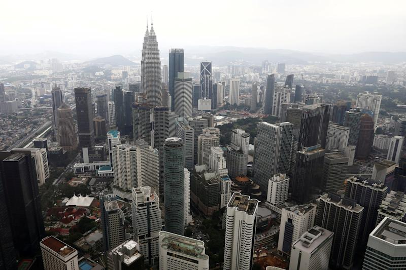 An Emir Research poll found that the majority of Malaysians remain unconvinced by the new government's policies to stop corporations from monopolising business. — Reuters pic