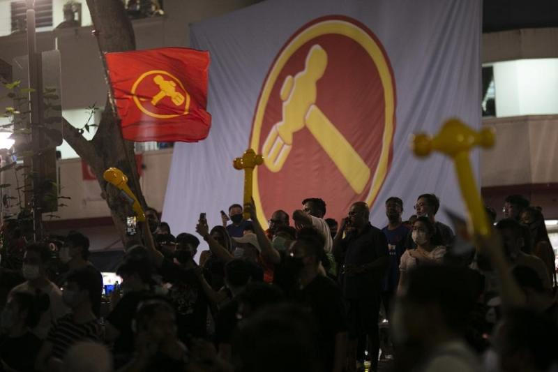 Workers' Party supporters gathered and cheered at Block 322 Hougang Avenue 5 in Hougang SMC as the GE2020 results were announced. — TODAY pic