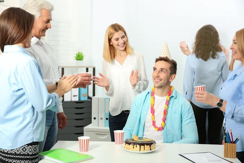 A man celebrating a birthday at work.