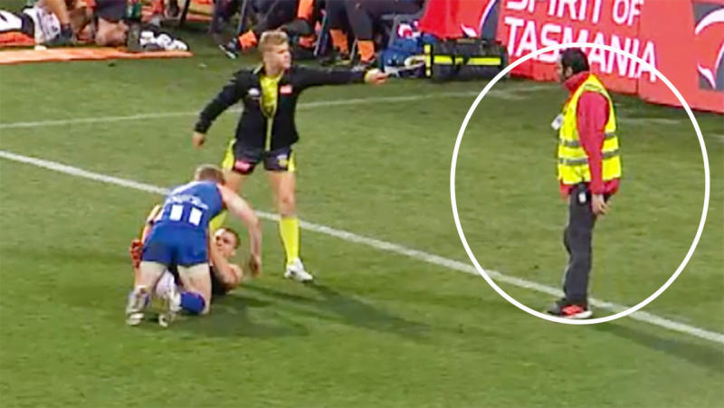 The security guard actually stepped onto the field. Image: Fox Footy
