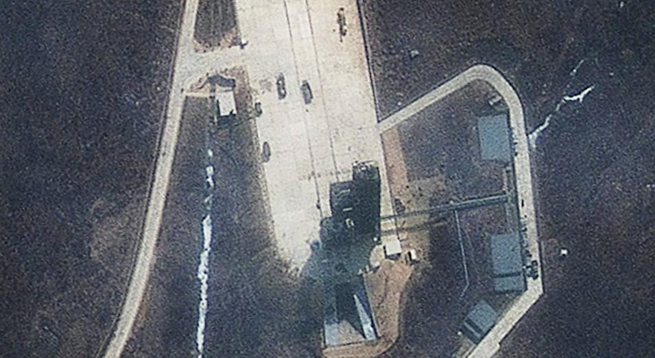 "This March 31, 2012 satellite image released by GeoEye Monday April 9, 2012 shows continued activity at the launch pad of the Tongchang-ri Launch Facility on North Korea's western coast. The image shows vehicles on the launch pad, nearby fuel and oxidizer containers and a crane above the launch tower that has been placed ""directly over the mobile launch platform, the position necessary to erect the rocket"", according to an analysis by IHS Jane's Defense Weekly. North Korea says it plans to launch a satellite into space from the launch pad to mark the 100th anniversary of national founder Kim Il Sung's birth. (AP Photo/GeoEye/IHS Global)"