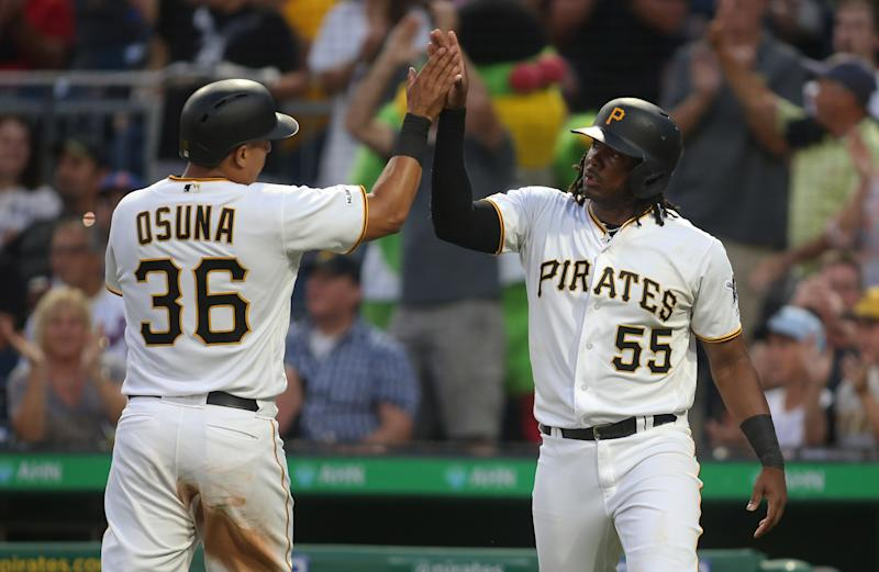 Aug 2, 2019; Pittsburgh, PA, USA; Pittsburgh Pirates third baseman Jose Osuna (36) and first baseman Josh Bell (55) celebrate after scoring runs against the New York Mets fourth inning at PNC Park. Mandatory Credit: Charles LeClaire-USA TODAY Sports