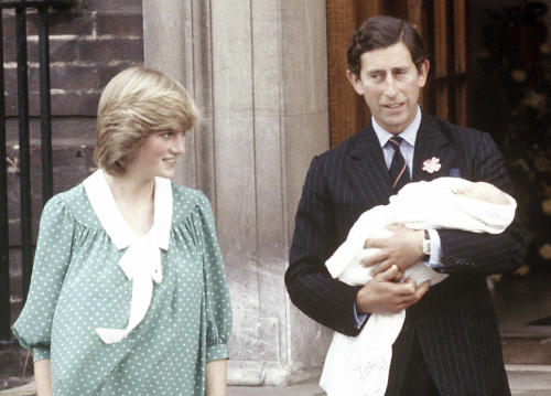 FILE - In this June 22, 1982, file photo, Britain's Prince Charles, Prince of Wales, and wife Princess Diana take home their newborn son Prince William, as they leave St. Mary's Hospital in London. It was announced on Monday, July 22, 2013, in London that Kate, Duchess of Cambridge and her husband Prince William, the Duke of Cambridge, gave birth to a boy weighting 8lbs 6 oz. (AP Photo/John Redman, File)