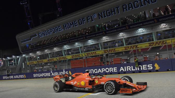 Pembalap Ferrari Sebastian Vettel (AFP/Roslan Rahman)