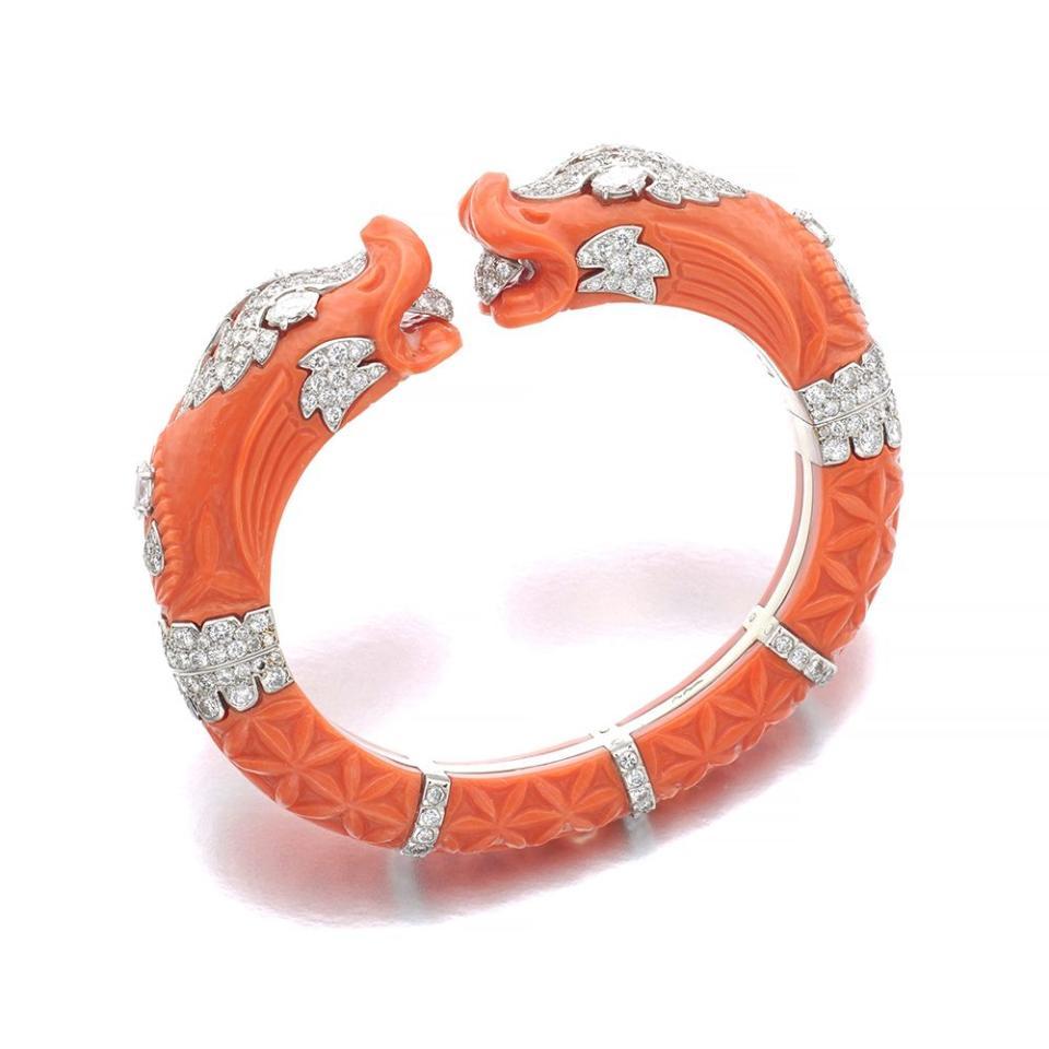 <p><em>Lot 11 Cartier | Coral and diamond bangle, circa 1970 CHF 50,000 – 80,000</em></p>