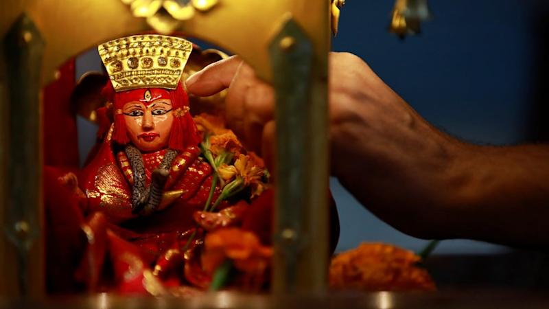 An idol of the Living Goddess Kumari is pictured inside the miniature chariot kept on display during the annual festival of Indra Jatra as the official celebration has been cancelled due to the spread of the coronavirus disease (COVID-19) in Kathmandu, Nepal September 2, 2020