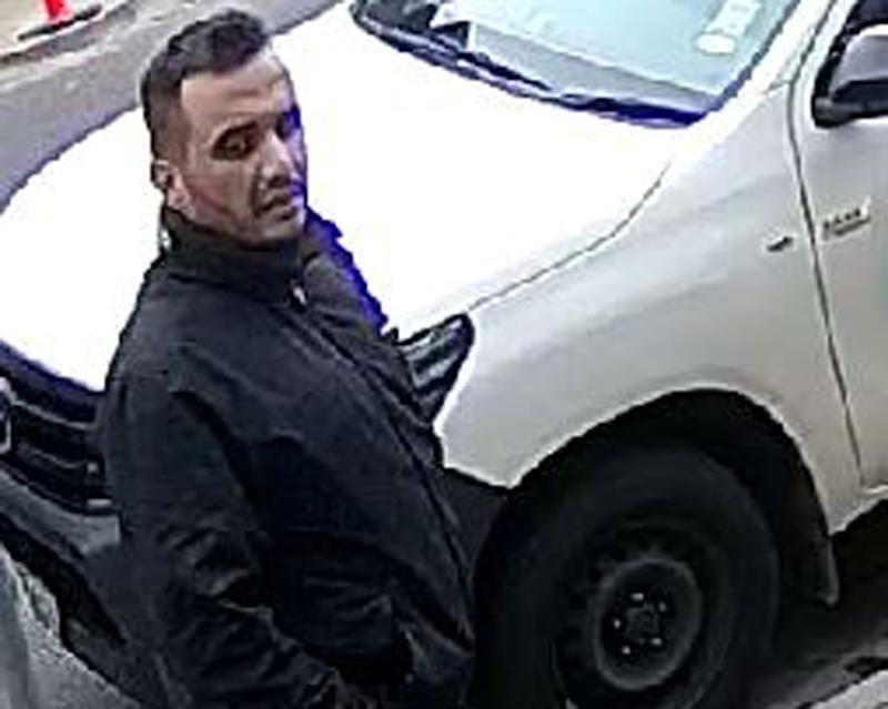 Pictured is a man police wish to speak with. Police said a man scaled a fence at Port Melbourne on Sunday between 12.30pm and 1.15pm and stole Staffordshire Bull Terrier named Ava.