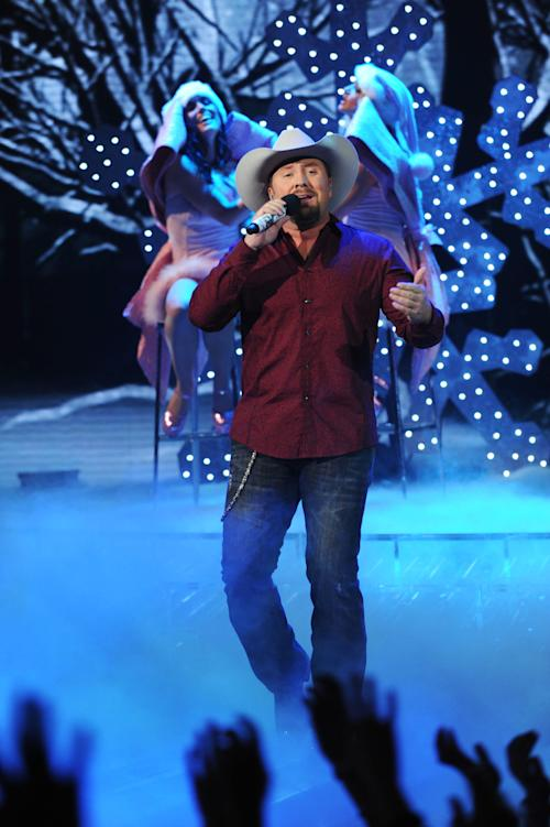 "FILE - In this Dec. 20, 2012 publicity photo released by FOX, finalist, Tate Stevens, performs during ""The X Factor"" Finale, on FOX. Stevens, who won Season 2 of Simon Cowell's ""The X-Factor,"" has signed a record deal with Syco Music/RCA Records Nashville, announced Tuesday, Jan. 15, 2013. He is currently writing and recording his debut album set to be released this spring. (AP Photo/FOX, Ray Mickshaw, File)"