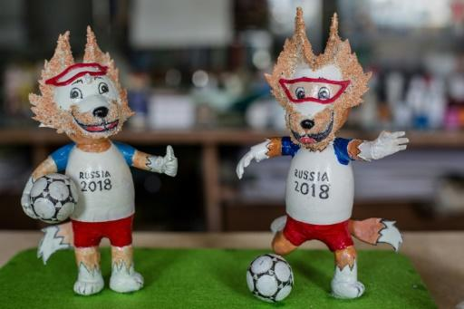 Most of the tiny statues are of tournament mascot Zabivaka, a wolf in sports goggles kicking a football