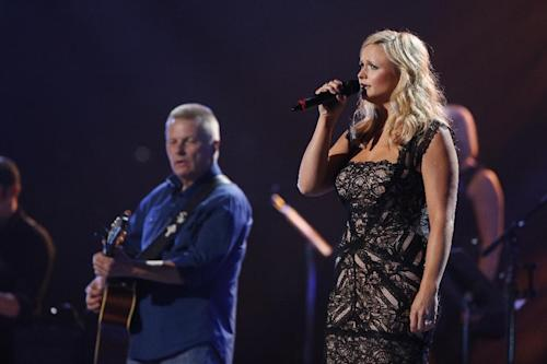 This image released by NBC Universal shows country singer Miranda Lambert, right, during the Healing in the Heartland: Relief Benefit Concert at the Chesapeake Energy Arena in Oklahoma City, Okla., Wednesday, May 29,2013. Funds raised by the benefit will go to the United Way of Central Oklahoma, for recovery efforts for those affected by the May 20 tornado. (AP Photo/NBC, Trae Patton)