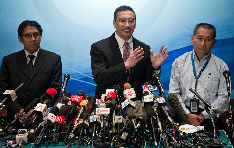 Malaysia's Minister of Defence and Acting Transport Minister Hishammuddin Hussein (C) answers questions from journalists during a press conference at a hotel near Kuala Lumpur International Airport (KLIA) in Sepang on March 13, 2014
