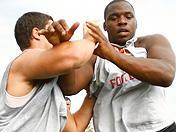 Trojan linemen drills at USC summer workouts