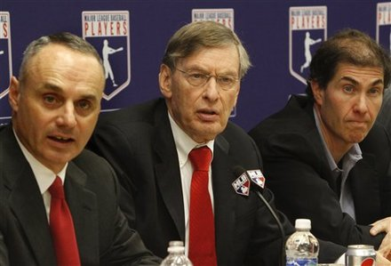 Major League Baseball Commissioner Bud Selig, Center, Is Flanked By Vice President Of Labor Relations Rob Manfred, Left,