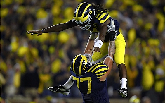 Michigan forgets everything it knows about football, and lets Denard Robinson take it from there