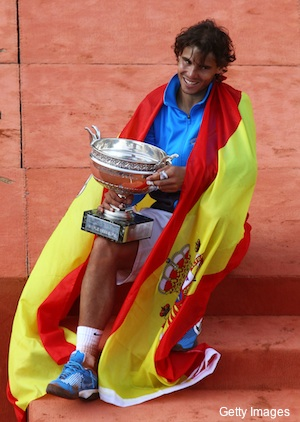 Six pictures of Rafael Nadal with his sixth French Open trophy