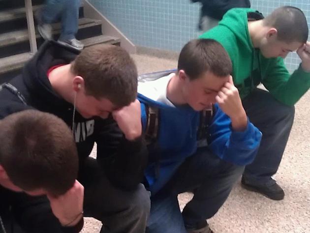 Riverhead High students Tebowing (Connor Carroll photo)