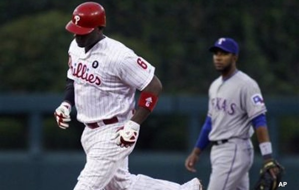 Ryan Howard circles the bases after a homerun against the Rangers