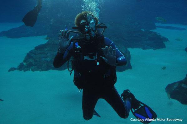 Brian Vickers swims with the sharks at Georgia Aquarium
