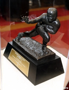 Heisman on the run: '05 trophy back with Bush's parents