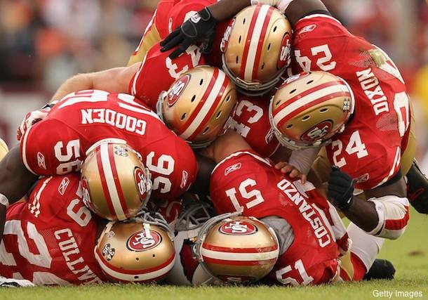 Create-a-caption: Six 49ers, one football