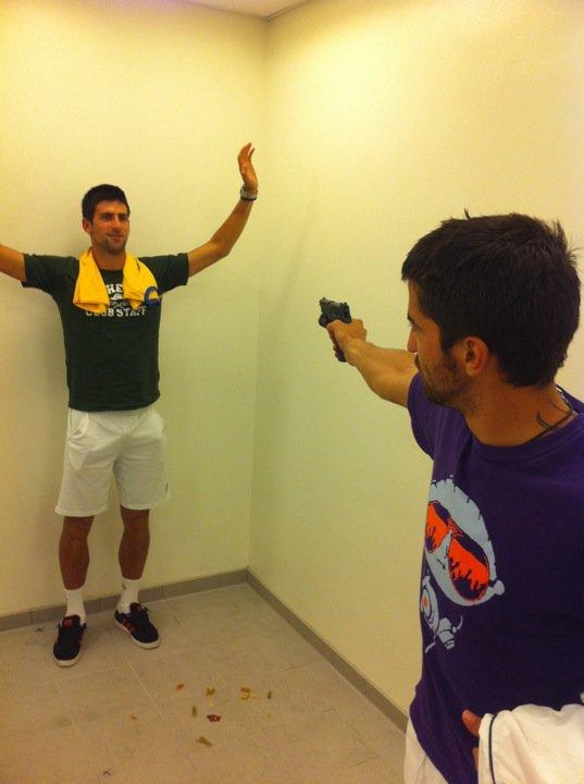 Photo: Novak Djokovic jokes around with a gun pointed at him
