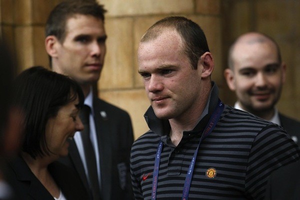 Rooney gets hair transplant, promises pictures