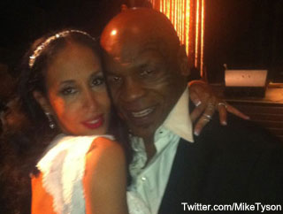 Tyson pulls a fast one in Vegas, renews his wedding vows at birthday party