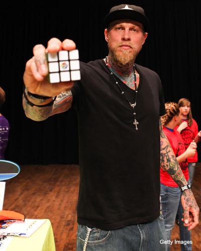 Chris Andersen encourages children to solve Rubik's Cubes