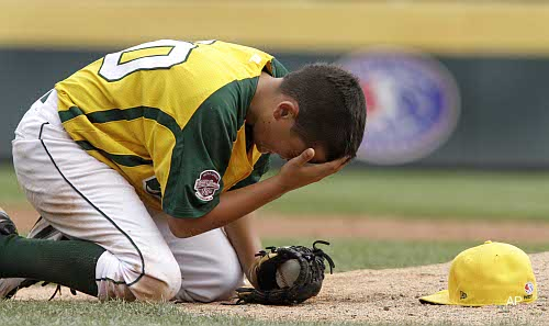 He's OK, folks! Little League World Series pitcher takes liner off cap
