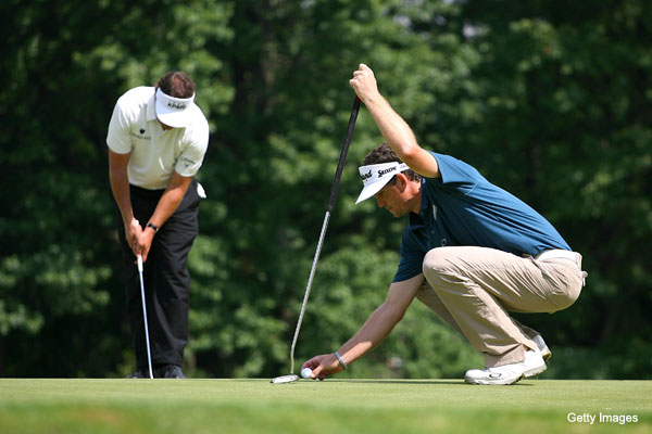 End of days: Phil Mickelson gives the belly putter a whirl