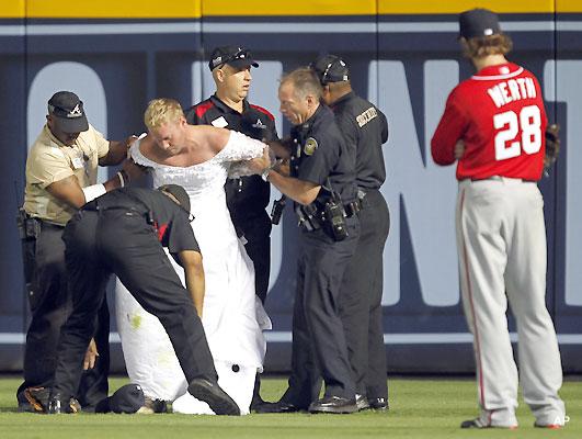 Runaway bride! Man in wedding dress interrupts Braves game