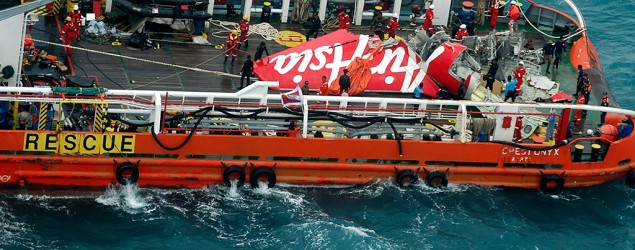 Tail of AirAsia Flight QZ8501 is seen on deck of Indonesian ship. (Reuters)