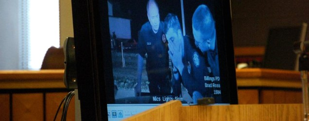 Police officer breaks down after fatal shooting. (AP)