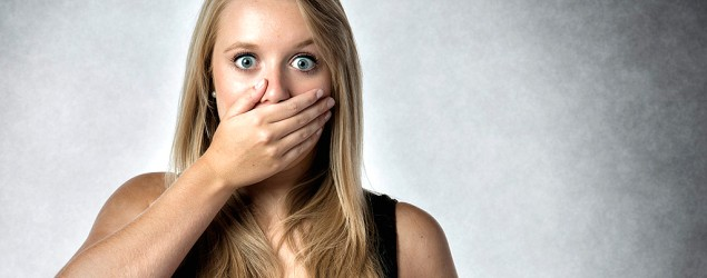 A woman covering her mouth (Thinkstock)