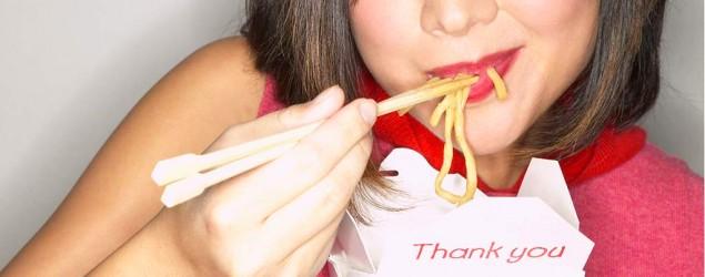 Woman eating with chopsticks (Thinkstock)