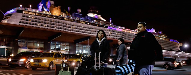 Passengers from the Anthem of the Seas cruise ship await transportation after arriving at Cape Liberty cruise port in Bayonne, N.J. (Julie Jacobson/AP)