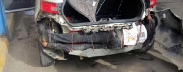 Shocking Image Shows Man Found Hidden In Smuggler's Car Bumper