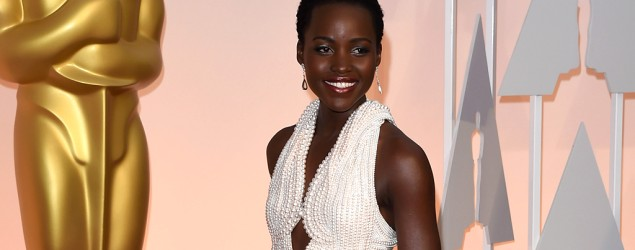 Lupita Nyong'o walks the red carpet at the Oscars in a pearl-laden gown by Calvin Klein (Jason Merritt/Getty Images)